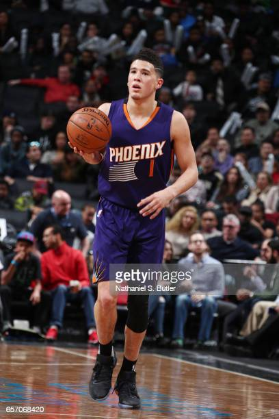Devin Booker of the Phoenix Suns handles the ball against the Brooklyn Nets during the game on March 23 2017 at Barclays Center in Brooklyn New York...