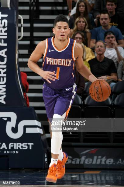 Devin Booker of the Phoenix Suns handles the ball against the Utah Jazz on October 6 2017 at vivintSmartHome Arena in Salt Lake City Utah NOTE TO...