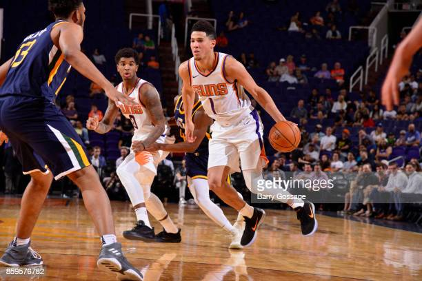 Devin Booker of the Phoenix Suns handles the ball against the Utah Jazz on October 9 2017 at Talking Stick Resort Arena in Phoenix Arizona NOTE TO...
