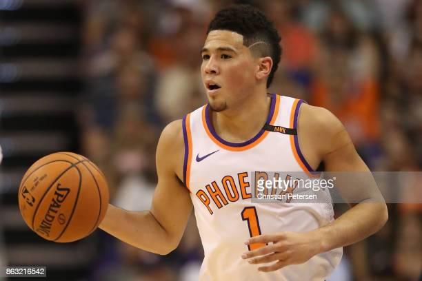 Devin Booker of the Phoenix Suns handles the ball during the first half of the NBA game against the Portland Trail Blazers at Talking Stick Resort...