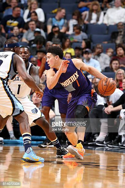 Devin Booker of the Phoenix Suns handles the ball during the game against the Memphis Grizzlies on March 6 2016 at FedExForum in Memphis Tennessee...