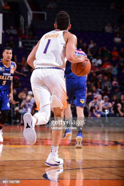 Devin Booker of the Phoenix Suns handles the ball during the preseason game against the Brisbane Bullets on October 13 2017 at Talking Stick Resort...