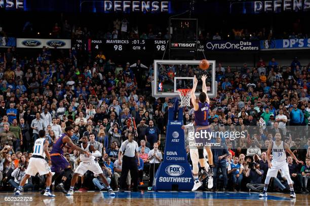 Devin Booker of the Phoenix Suns knocks down a fadeaway jumper as time expired to give the Suns a 10098 victory over the Dallas Mavericks on March 11...