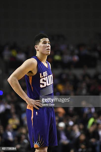 Devin Booker of the Phoenix Suns looks on during the game against the San Antonio Spurs as part of NBA Global Games at Arena Ciudad de Mexico on...