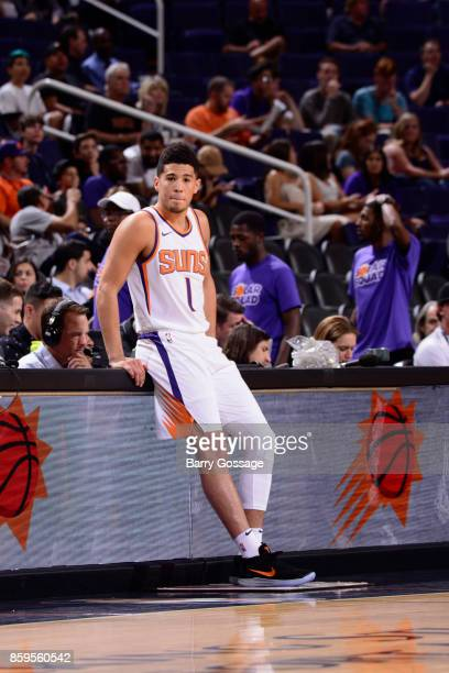 Devin Booker of the Phoenix Suns looks on during the game against the Utah Jazz on October 9 2017 at Talking Stick Resort Arena in Phoenix Arizona...