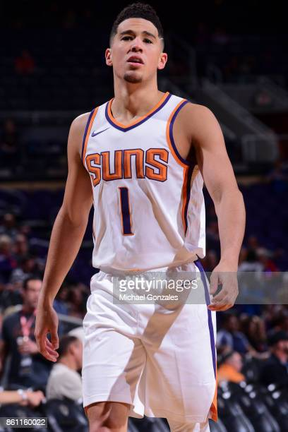 Devin Booker of the Phoenix Suns looks on during the preseason game against the Brisbane Bullets on October 13 2017 at Talking Stick Resort Arena in...