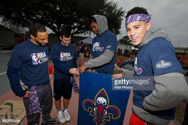Devin Booker of the Phoenix Suns participates during the NBA Cares Day of Service as part of 2017 AllStar Weekend at the KaBOOM Rebuilding Together...