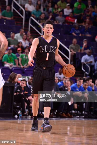 Devin Booker of the Phoenix Suns passes the ball against the Orlando Magic on March 17 2017 at Talking Stick Resort Arena in Phoenix Arizona NOTE TO...