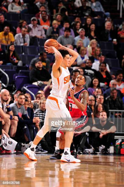 Devin Booker of the Phoenix Suns passes the ball against the Washington Wizards during the game on March 7 2017 at Talking Stick Resort Arena in...