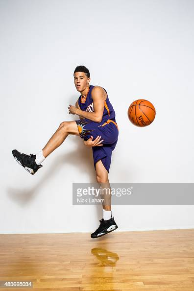 Devin Booker of the Phoenix Suns poses for a portrait during the 2015 NBA rookie photo shoot on August 8 2015 at the Madison Square Garden Training...