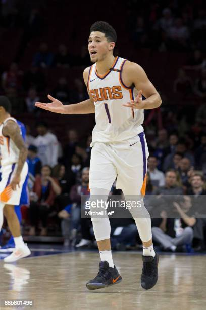 Devin Booker of the Phoenix Suns reacts after making a three point basket in the fourth quarter against the Philadelphia 76ers at the Wells Fargo...