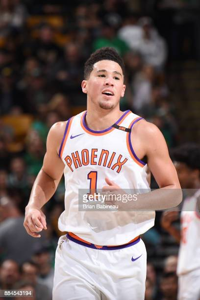 Devin Booker of the Phoenix Suns reacts during the game against the Boston Celtics on December 2 2017 at the TD Garden in Boston Massachusetts NOTE...