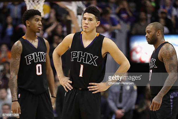Devin Booker of the Phoenix Suns reacts during the second half of the NBA game against the New York Knicks at Talking Stick Resort Arena on December...