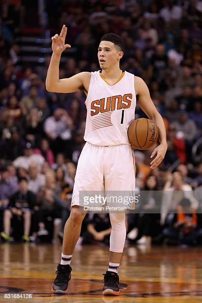 Devin Booker of the Phoenix Suns reacts during the second half of the NBA game against the Cleveland Cavaliers at Talking Stick Resort Arena on...