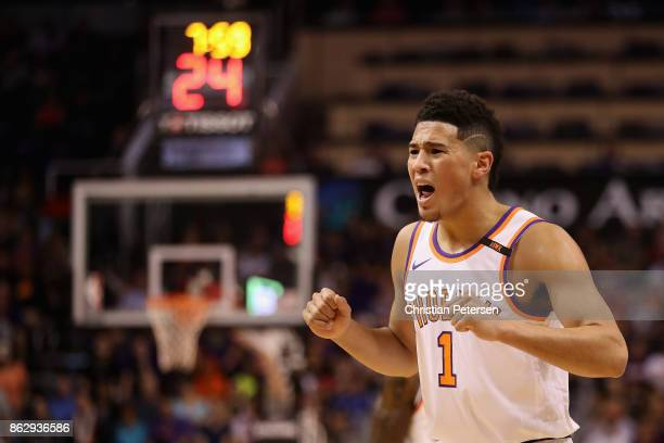 Devin Booker of the Phoenix Suns reacts to a call during the first half of the NBA game against the Portland Trail Blazers at Talking Stick Resort...