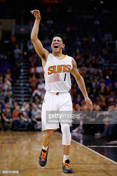 Devin Booker of the Phoenix Suns reacts to a missed three point shot against the Indiana Pacers during the first half of the NBA game at Talking...