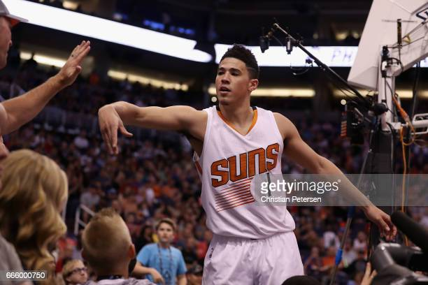 Devin Booker of the Phoenix Suns reacts to fans after scoring against the Oklahoma City Thunder during the second half of the NBA game at Talking...