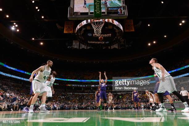 Devin Booker of the Phoenix Suns shoots a free throw against the Boston Celtics on March 24 2017 at the TD Garden in Boston Massachusetts NOTE TO...