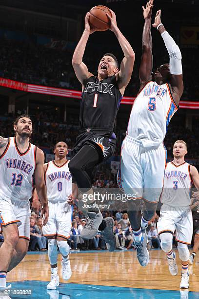 Devin Booker of the Phoenix Suns shoots a lay up against the Oklahoma City Thunder on October 28 2016 at the Chesapeake Energy Arena in Oklahoma City...