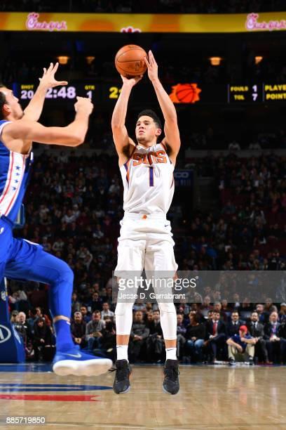Devin Booker of the Phoenix Suns shoots the ball against the Philadelphia 76ers on December 4 2017 at Wells Fargo Center in Philadelphia Pennsylvania...