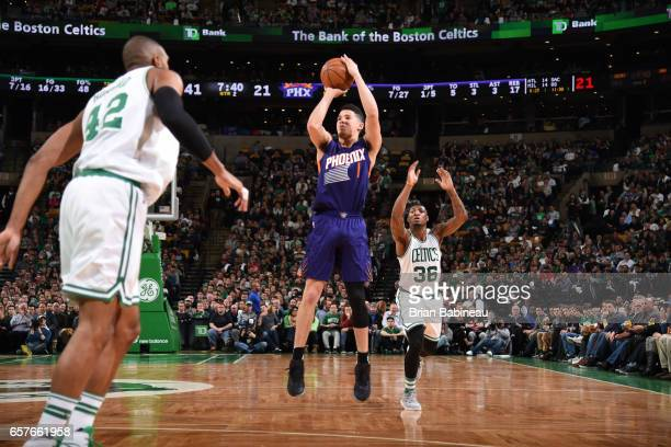 Devin Booker of the Phoenix Suns shoots the ball against the Boston Celtics on March 24 2017 at TD Garden in Boston Massachusetts NOTE TO USER User...