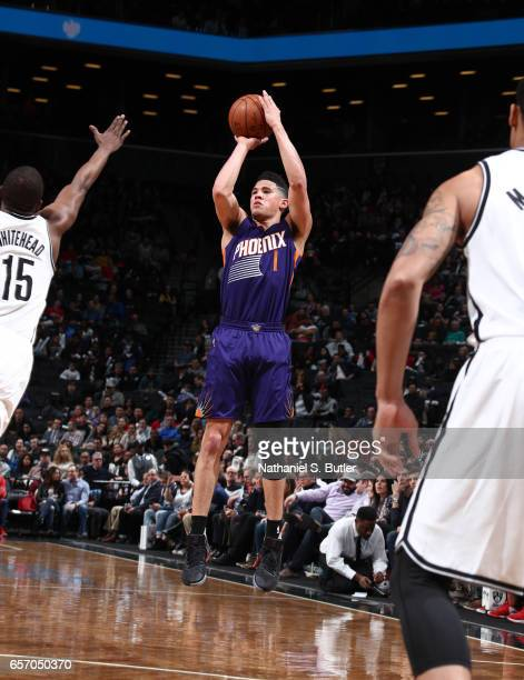 Devin Booker of the Phoenix Suns shoots the ball against the Brooklyn Nets during the game on March 23 2017 at Barclays Center in Brooklyn New York...