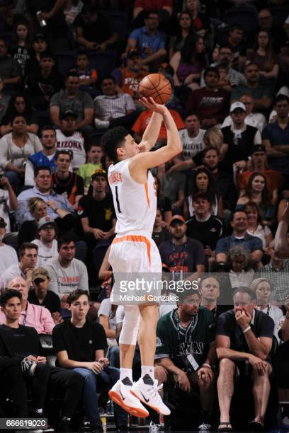 Devin Booker of the Phoenix Suns shoots the ball against the Dallas Mavericks on April 9 2017 at Talking Stick Resort Arena in Phoenix Arizona NOTE...