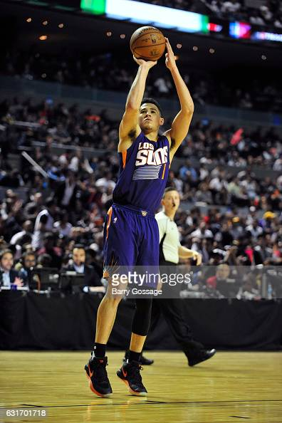 Devin Booker of the Phoenix Suns shoots the ball against the San Antonio Spurs as part of NBA Global Games at Arena Ciudad de Mexico on January 14...