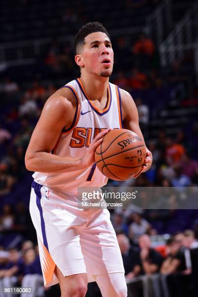 Devin Booker of the Phoenix Suns shoots the ball during the preseason game against the Brisbane Bullets on October 13 2017 at Talking Stick Resort...