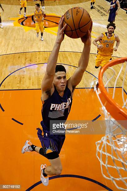 Devin Booker of the Phoenix Suns slam dunks the ball against the Cleveland Cavaliers during the first half of the NBA game at Talking Stick Resort...