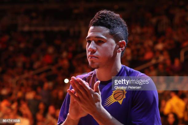 Devin Booker of the Phoenix Suns stands on the court before the NBA game against the Los Angeles Lakers at Talking Stick Resort Arena on October 20...