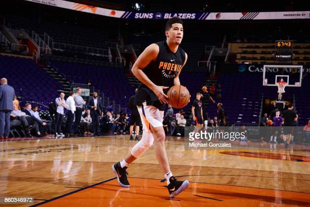 Devin Booker of the Phoenix Suns warms up before the preseason game against the Portland Trail Blazers on October 11 2017 at Talking Stick Resort...