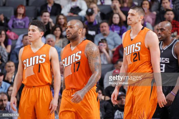 Devin Booker PJ Tucker and Alex Len of the Phoenix Suns face off against the Sacramento Kings on February 3 2017 at Golden 1 Center in Sacramento...