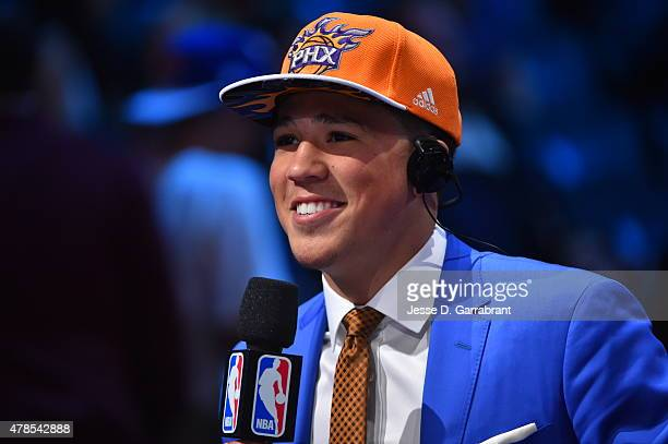Devin Booker the 13th pick overall in the 2015 NBA Draft by the Phoenix Suns speaks to the media during the 2015 NBA Draft at the Barclays Center on...