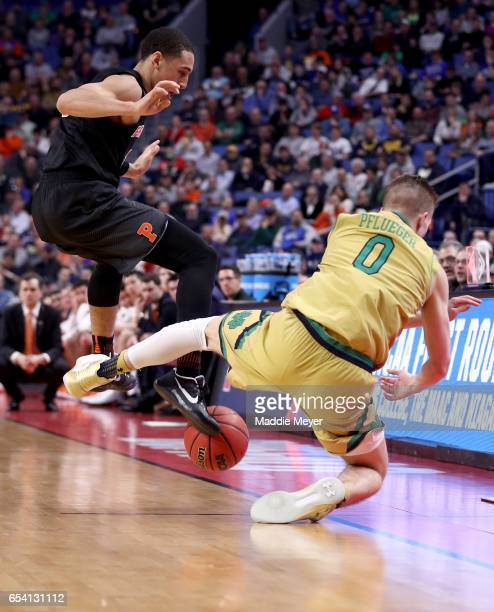 Devin Cannady of the Princeton Tigers and Rex Pflueger of the Notre Dame Fighting Irish look to save the ball during the first round of the 2017 NCAA...
