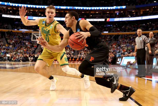Devin Cannady of the Princeton Tigers drives to the basket against Rex Pflueger of the Notre Dame Fighting Irish during the first round of the 2017...