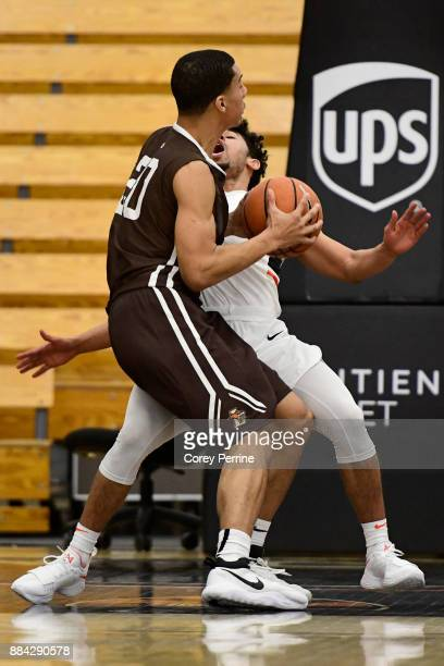 Devin Cannady of the Princeton Tigers is fouled by Marques Wilson of the Lehigh Mountain Hawks during the first half at L Stockwell Jadwin Gymnasium...