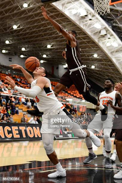 Devin Cannady of the Princeton Tigers is fouled in the lane against Kyle Leufroy of the Lehigh Mountain Hawks during the first half at L Stockwell...