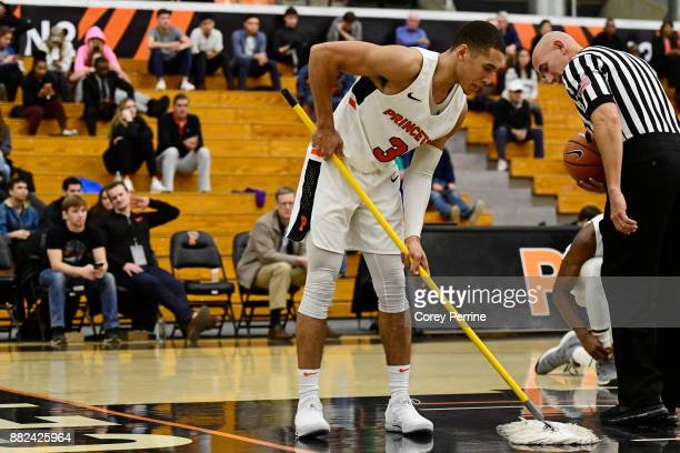 Devin Cannady of the Princeton Tigers mops up the floor as referee Garrick Shannon looks on against the Lehigh Mountain Hawks during the second half...