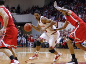 Devin Davis of the Indiana Hoosiers drives to the basket during the game against the Ohio State Buckeyes at Assembly Hall on March 2 2014 in...