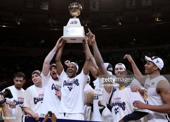 Devin Ebanks and the West Virginia Mountaineers celebrate with the trophy after defeating the Georgetown Hoyas in the championship of the 2010 NCAA...
