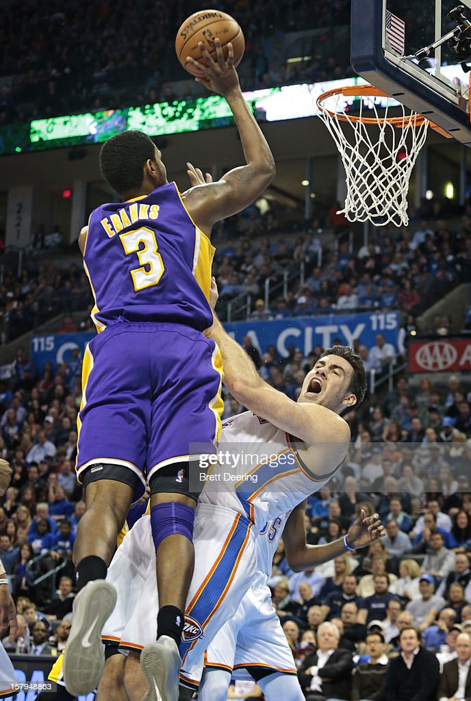 Devin Ebanks #3 of the Los Angeles Lakers commits an offensive foul against Nick Collison #4 of the Oklahoma City Thunder December 7, 2012 at Chesapeake Energy Arena in Oklahoma City, Oklahoma. Oklahoma City defeated Los Angeles 114-108.