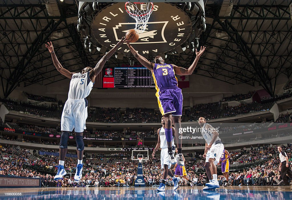 Devin Ebanks #3 of the Los Angeles Lakers grabs a rebound against <a gi-track='captionPersonalityLinkClicked' href=/galleries/search?phrase=Bernard+James&family=editorial&specificpeople=7387529 ng-click='$event.stopPropagation()'>Bernard James</a> #5 of the Dallas Mavericks on November 24, 2012 at the American Airlines Center in Dallas, Texas.