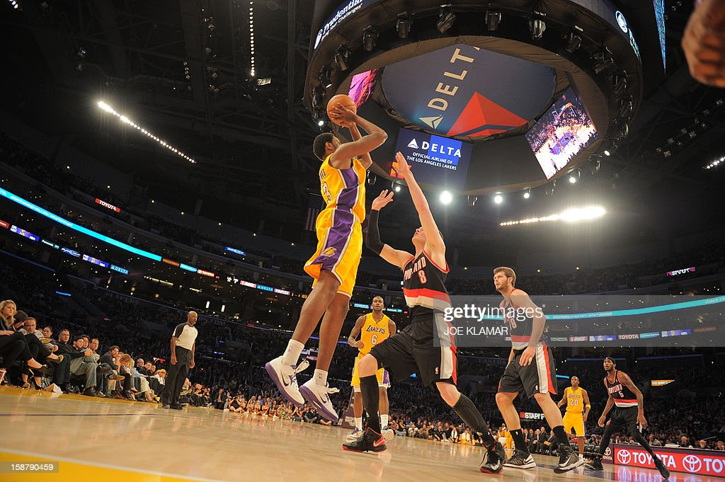 Devin Ebanks (L) of the Los Angeles Lakers shoots before Luke Babbitt (R) of the Portland Trail Blazers during their NBA game on December 28, 2012 at Staples Center in Los Angeles, California. The Lakers rolled over the Blazers 104-87. AFP PHOTO / Joe KLAMAR