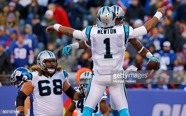 Devin Funchess of the Carolina Panthers celebrates with Cam Newton after scoring a 14 yard touchdown in the second quarter against the New York...