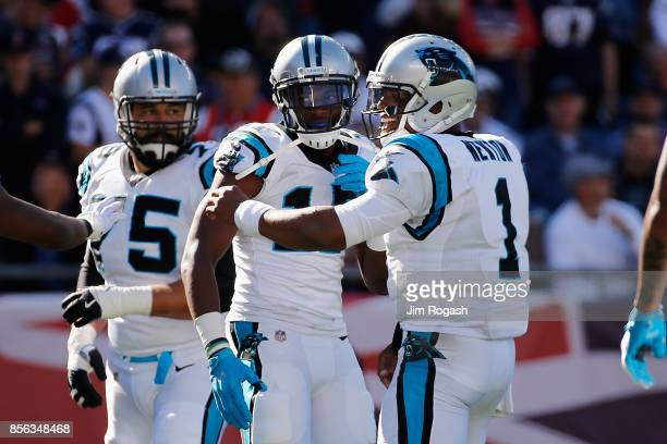 Devin Funchess of the Carolina Panthers celebrates with Cam Newton after scoring a touchdown during the third quarter against the New England...