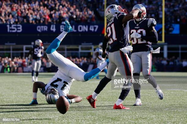Devin Funchess of the Carolina Panthers is upended during the second half against the New England Patriots at Gillette Stadium on October 1 2017 in...