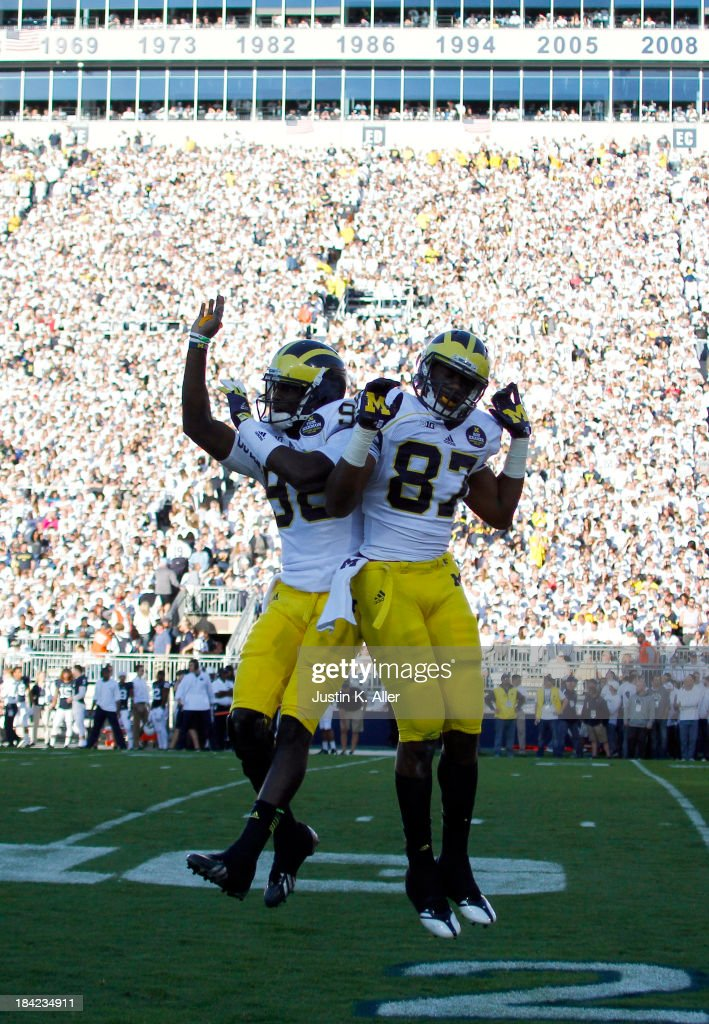 Devin Funchess #87 of the Michigan Wolverines celebrates after scoring a 59 yard touchdown in the first half against the Penn State Nittany Lions during the game on October 12, 2013 at Beaver Stadium in State College, Pennsylvania.