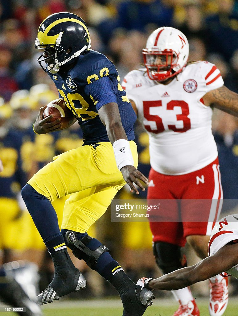 <a gi-track='captionPersonalityLinkClicked' href=/galleries/search?phrase=Devin+Gardner&family=editorial&specificpeople=6427914 ng-click='$event.stopPropagation()'>Devin Gardner</a> #98 of the Michigan Wolverines breaks a tackle in the second half against the Nebraska Cornhuskers at Michigan Stadium on November 9, 2013 in Ann Arbor, Michigan.