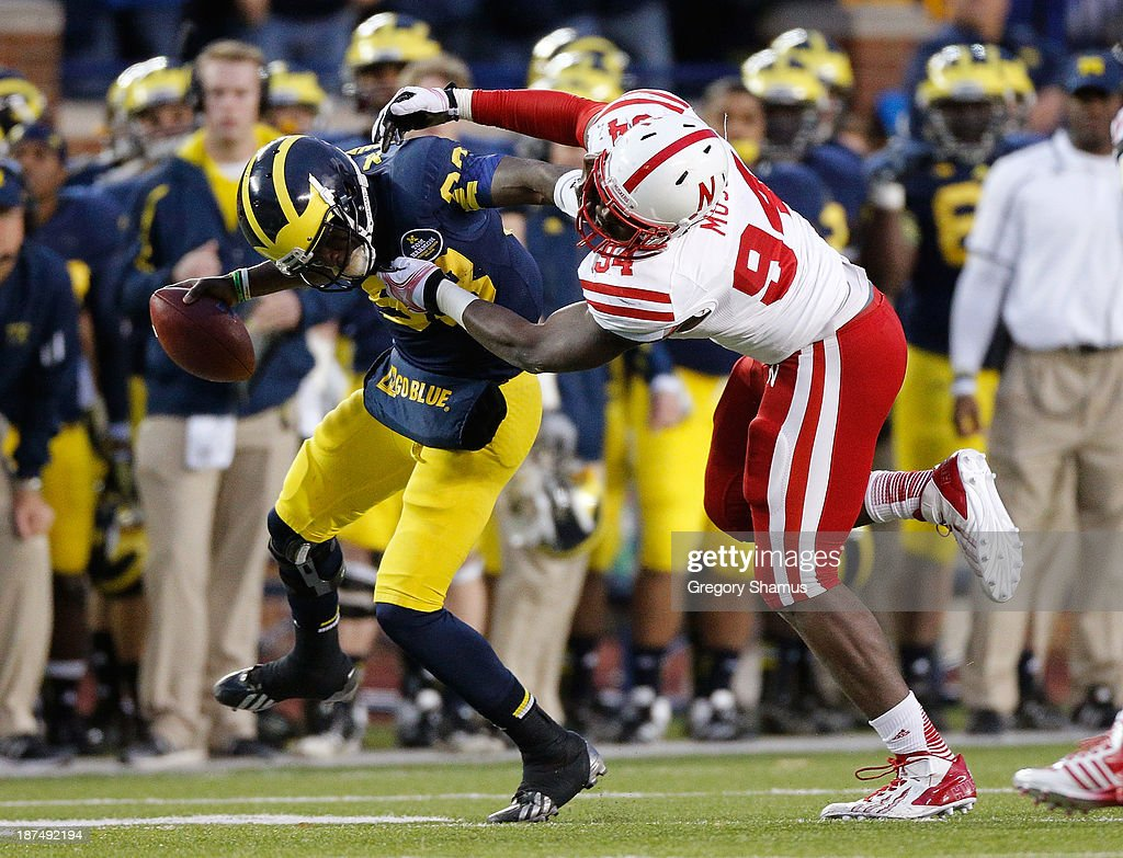 <a gi-track='captionPersonalityLinkClicked' href=/galleries/search?phrase=Devin+Gardner&family=editorial&specificpeople=6427914 ng-click='$event.stopPropagation()'>Devin Gardner</a> #98 of the Michigan Wolverines is dragged down by Avery Moss #94 of the Nebraska Cornhuskers in the second quarter at Michigan Stadium on November 9, 2013 in Ann Arbor, Michigan.